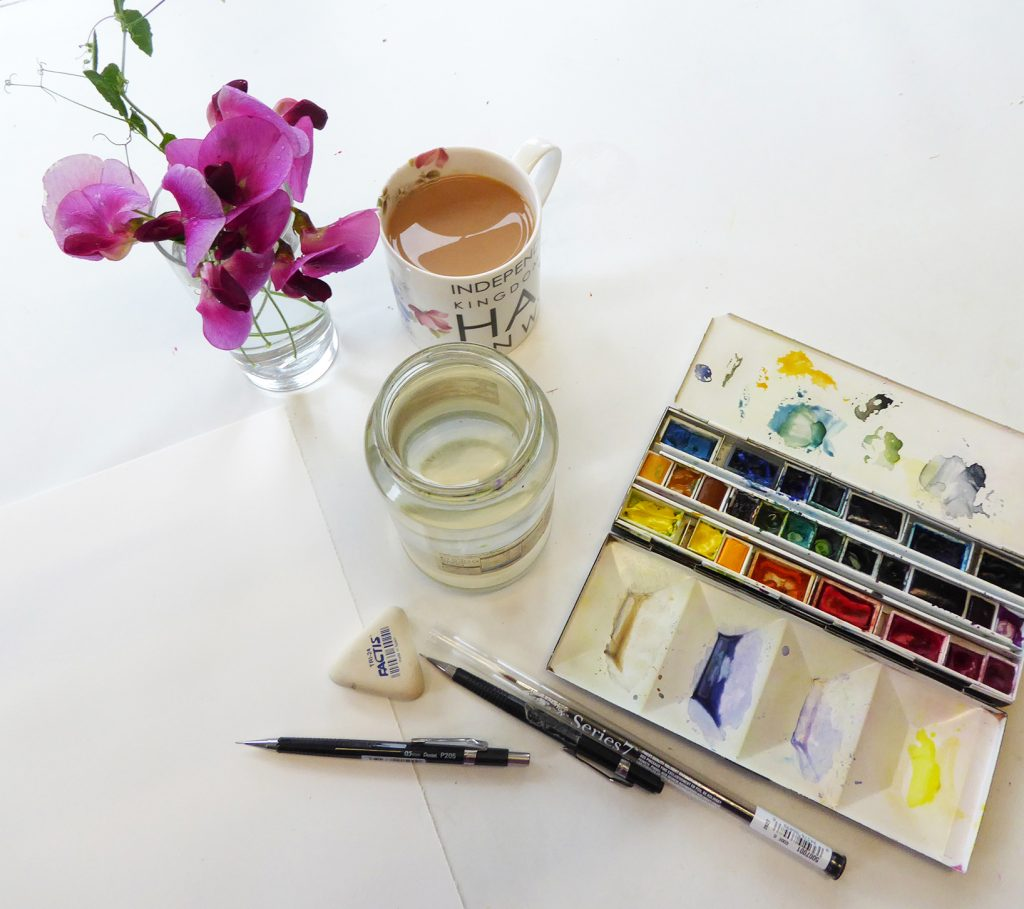 Set up showing sweet pea flower and paintbox