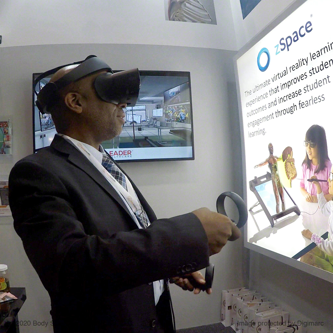 Man wearing a VR headset in front of a screen